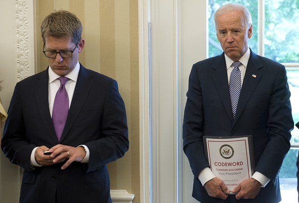 US Vice President Joe Biden (R) and White House Press Secretary Jay Carney attend a meeting between US President Barack Obama and Israeli Prime Minister Benjamin Netanyahu in the Oval Office of the White House in Washington, DC, September 30, 2013. Credit: AFP/Getty Images